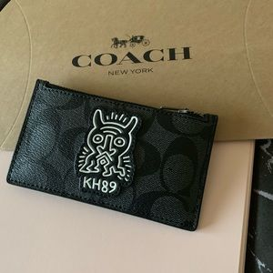 KEITH HARING ZIP CARD CASE IN SIGNATURE CANVAS